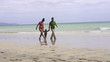 Happy family walking on the beach, super slow motion
