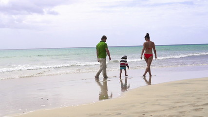 Family walking on beautiful the beach