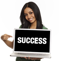 Young woman holding laptop with success