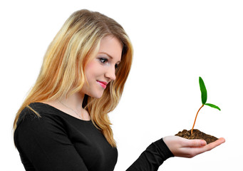 Girl holding in hand growing  plant