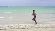 Woman jogging on beautiful beach, super slow motion