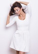 Beautiful woman in white dress by on white isolated