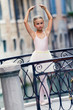 Portrait of lovely dancing ballerina in Venice