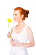 Woman with yellow flower near her face on white background