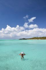 Girl in the turqouise water of Atlantic. Exuma, Bahamas