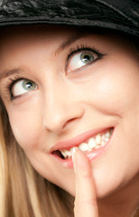 Smiling woman showing shush