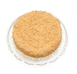 honey cake on a beautiful glass plate