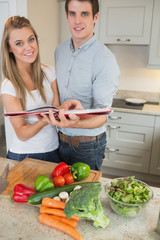 Happy couple with cookery book