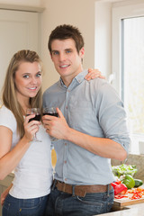 Young couple clinking wine glasses