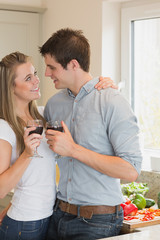 Couple drinking wine and looking into each others eyes