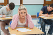 Stressed student sitting in a classroom