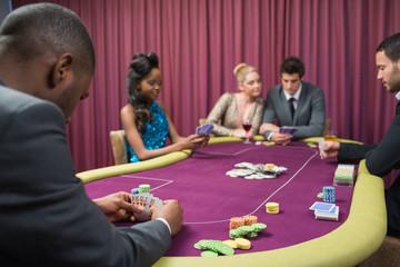 Man looking at his poker cards