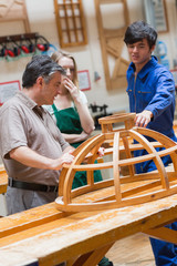 Woodwork class talking about a structure