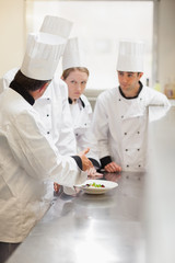 Head chef explaining something to class