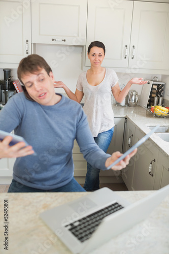 Man busy with technology while his wife wondering why