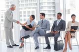 Director welcoming businesswoman