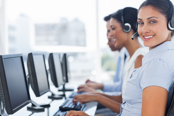 Smiling call center employee looking at camera