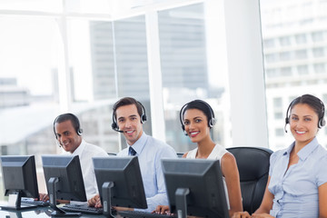 Line of call centre employees smiling
