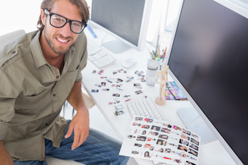 Photo editor at his desk