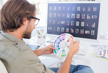 Photo editor looking at colour wheel