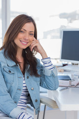 Beautiful designer smiling in creative office