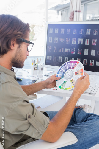 Editor looking at colour wheel