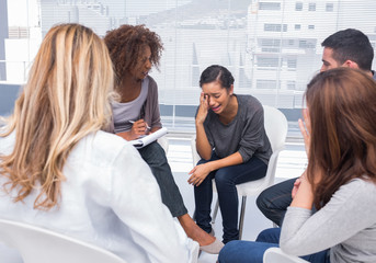 Woman getting distressed in group therapy