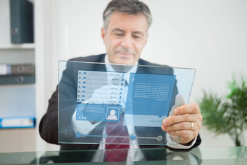 Businessman using futuristic touchscreen to view social network