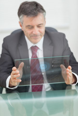 Buisnessman using futuristic touchscreen