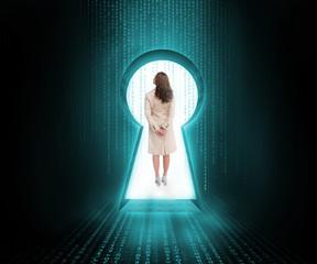 Businesswoman standing in keyhole door