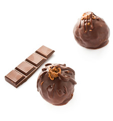 Two delicious dark chocolate candies isolated on a white backgro