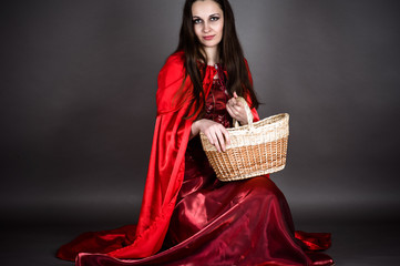 attractive woman sitting with a basket in hand