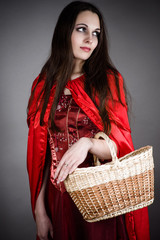 beautiful woman in the image of Little Red Riding Hood