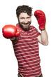 Man wearing boxing gloves smiling
