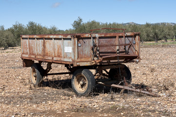 Old farm trailer on a fallow field