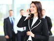 Beautiful business woman talking on cell phone