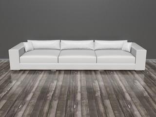 Grosse Couch vor grauer Wand