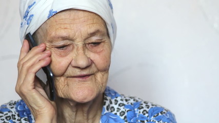 portrait of old woman talking on smartphone