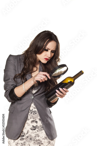 Women carefully read the label on a bottle of wine
