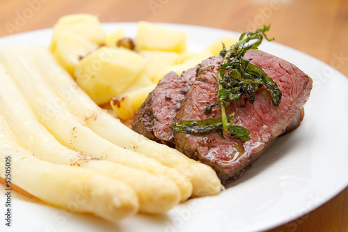 beef fillet with white asparagus and potatoes