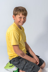 Young boy kneeling