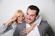 Cheerful trendy couple having fun
