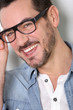 Portrait of cheerful man with eyeglasses on