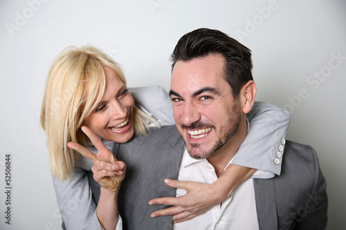 Cheerful trendy couple having fun