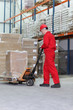 canvas print picture - worker with  pallet jack in warehouse