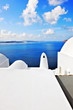 Typical architecture with stunning view over the caldera in Oia