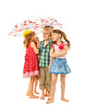Barefoot children under an umbrella