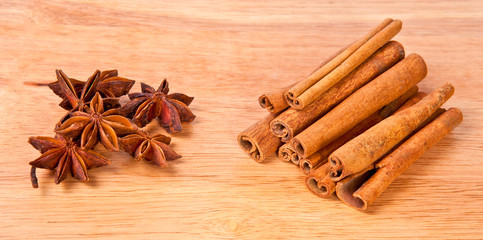 Cinnamon and anise on a wooden background