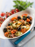 squid with tomatoes olives and capers, selective focus