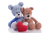 two teddy bears with red  heart pillow love